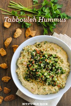 For a lazy day snack or easy party food, try this fresh Tabbouleh Hummus.  Loaded with chickpeas, garlic, parsley and fresh mint, they're the perfect  dip for your NatureBox Chia Seed Crackers!