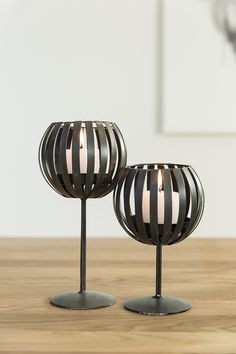 Pentik Pallo Candle Holder | Pallo (Ball) candle holder comes in two sizes, in white and brown. Made of painted metal, this candlestick can accommodate a big tealight.