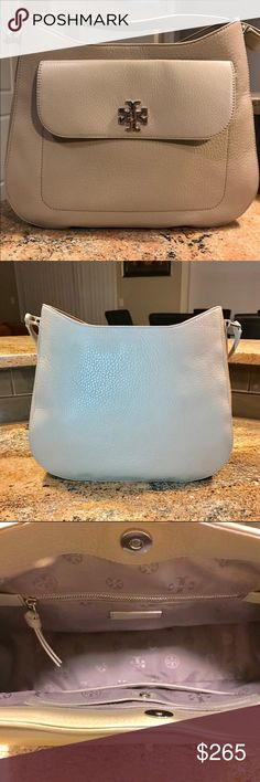 Tory Burch Hobo Bag Gorgeous Tory Burch hobo bag worn only a few times just not my style. I think it's so gorgeous. 13.5 in. L X 4 D X 9 W. Excellent condition with no damage whatsoever. Any questions please ask. Tory Burch Bags Satchels