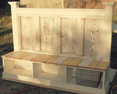 they turned a door and some bed slats into an outdoor bench - i'd use it on a porch, deck, or inside, too!  (mud room?)
