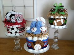 Play ball! A very sporty red, white and blue baseball mini diaper cake... perfect for a baby boy! This mini diaper cake makes a great shower gift or decoration/centerpiece. It also makes a stylish nursery decoration after the shower and is easily disassembled when baby is ready to use the diapers (and pacifier AND socks!)    Single Tier Mini Diaper Cake includes:  - 15 size 1 Pampers Swaddlers disposable diapers  - wood baseball/mitt decoration (perfect for the babys scrapbook!) wit...