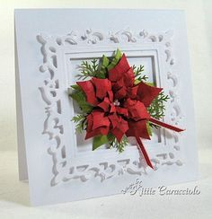 Christmas shelf art for simple holiday display. Red poinsettia, moss ferny greenery, white embossed card stock with narrow red ribbon.