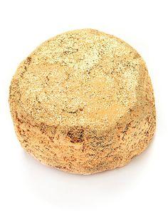 Lush Bomba de baño con polvo de oro.