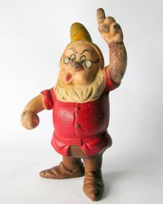 Vintage Walt Disney DOC Figurine from Snow White and the Seven Dwarfs. Doc is 5 3/4 tall, has some wear and cracking to the paint, and requires a good