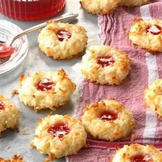 Jeweled Coconut Drops Recipe -Red raspberry preserves add a festive flair to these tender coconut cookies. Perfect for potlucks and cookie exchanges, these shaped cookies never last long when I make them for my husband and two sons. -Ellen Marie Byler Munfordville, Kentucky