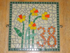 Daffodils. Stained glass and vitreous tile mosaic house number 38 | Flickr - Photo Sharing!   Love this house number design!