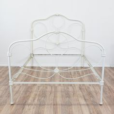 This antique bed frame is featured in an iron metal with a distressed white finish. This full sized bed frame is in great condition with a curved top, swirl details and carved decor. Unique vintage bed perfect for a light and airy bedroom! #traditional #beds #bedframe #sandiegovintage #vintagefurniture