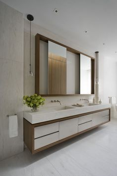 love this look for the master - wood and white vanity with storage, thick counter top with integrated sinks, hanging light fixtures, wall mount faucets