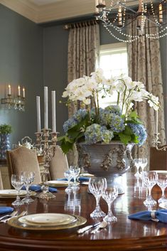 An updated traditional look with some glamour thrown in. I love the floral arrangement & the wall color.