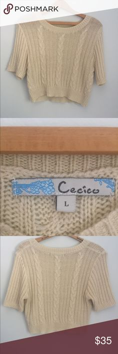 Cream colored cropped sweater top Keeps you super warm! Cute with skirt or high waisted jeans. Never worn. Super nice quality. Cecico Tops Crop Tops