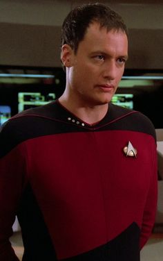 """Q - """"Star Trek: The Next Generation"""". I also have this uniform.  That makes three Q outfits that I own. The other two being the Sheriff of Nottingham and the most recognizable, Judge's Robes."""