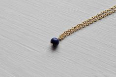 Tiny lapis blue colored bead necklace with a gold plated chain.    Its part of the new Little Darling* tiny little necklaces collection.    It