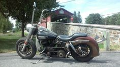 Harley Davidson FLH shovelhead rat bike in front of a covered bridge.