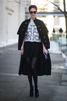 Coco Rocha turned the sidewalk into a runway with a cape draped over her shoulders. #streetstyle #nyfw
