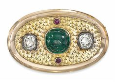 A LATE 19TH CENTURY RUSSIAN EMERALD AND DIAMOND BROOCH   The oval plaque with cabochon emerald centre, flanked to either side by single old-cut diamond collets and further ruby cabochon points, raised on a dimpled ground, to the polished bevelled border, circa 1890, Russian marks for gold, St Petersburg, 3.8cm wide  Maker's mark EK