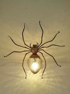 spider wall light - brass iron and glass insect light, about cm/ 20 in. can stand or sit.insect light, about cm/ 20 in. can stand or sit.