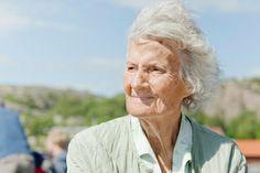 Older lady with wind through her hair | © HK Andersson / Scandinav Bildbyrå #People #Woman #Older #Freedom #Blue #White #Green #Scandinavian #Hair #Wind #Wrinkles #Lady