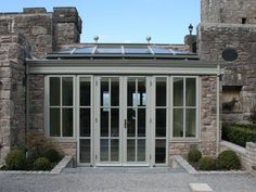 The perfect conservatory / garden room. Very nicely done. http://www.chelseaconservatories.com/