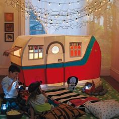 """Looking to cut down on """"Are we there yets?"""" for your next camping trip? Then you're in luck.  Our Jetaire Camper Play Tent brings the campsite into your home.  It features embroidered and patchwork details (even an awning and curtains) that look just like the real thing.  Add our The S'more the Merrier Campfire for a full indoor camping experience (sold separately)."""
