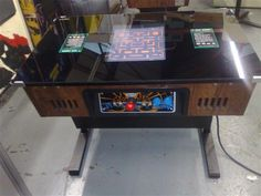 Sit down arcade with 60 retro games.... Would look great in the home utahsaint revaheyl