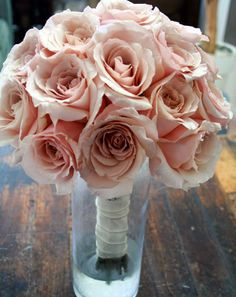 Great way to reuse bridesmaids bouquets at the reception