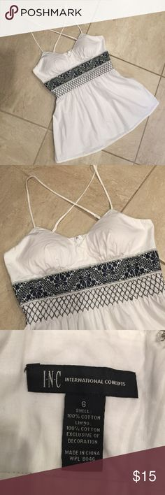 Cross Cross Top Excellent condition. Purchased recently but doesn't fit me. True to size (small). Straps are adjustable and back zips up. Cups have padding. No need to wear a bra. :) INC International Concepts Tops Blouses