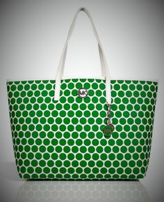 Perfect for Days at the Beach or Chic City Shopping, this Printed PVC Tote from Michael Kors Offers Cheerful Chic Style. You Can Take this Tote Anywhere, also Makes for a Fun Workday Style. Perfect for Work, Play, or Travel. See Suggested Photos for Various Looks. Retails at $198.00. Item Details...
