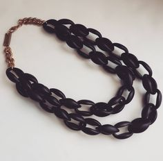 The black widow necklace is made from light weight acrylic links that are easily interchangeable or removed to create dramatic changes in length to suit every occasion