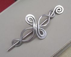 Pretty, bet my hair is too short now.  Celtic Shawl Pin/Hair Pin--Etsy: nicholasandfelice  $22.00
