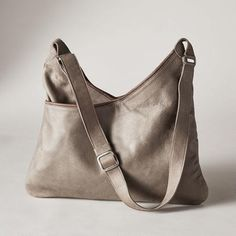 """CITY OF ANGELS BAG - Wonderfully supple, gently distressed leather hints at the care that goes into each of these luxurious, yet straight forward bags. Front and back pockets. Handcrafted in USA. Approx. 18""""W x 12""""D x 12""""H."""