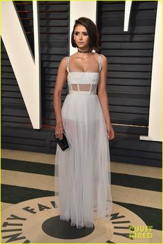 Nina Dobrev in Dior Couture attends the 2017 Vanity Fair Oscar Party. Celebrity Red Carpet, Celebrity Style, Celebrity News, White Corset, Vanity Fair Oscar Party, Glamour, Red Carpet Looks, Sheer Dress, Celebs