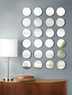 mirrors really open up a space and having something circle in a square room can make a huge difference