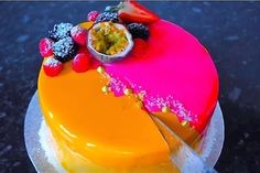 This stunning and elegant cake combines two of my favourite flavours passion fruit and mango. It consists of several layers and is covered in double mirror glaze to give it a special wow effect. This passion fruit and mango mousse is so spectacular and is of the best desserts I have ever made.