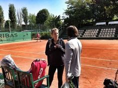 Victoria Azarenka having a quick word with her coach before her practice session! Do you think Azarenka is a favourite to win the title?