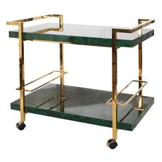 Bar cart with brass frame and malachite tiers.