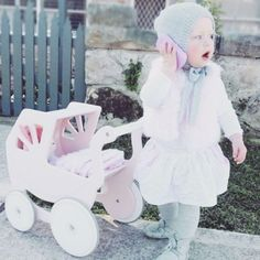 How adorable is this gorgeous girl playing with her Silver Cross wooden Pram? #ptbaby #itsagirl #baby #makebelieve #tgif
