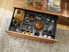 Why not store vases in a spacious drawer with flexible inner dividers instead of a shelf? Beautiful and practical idea for living room storage. More inspiration for your home on www.blum.com/ideas