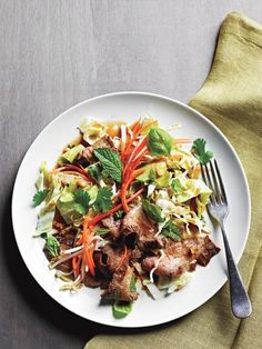 Thinly sliced, perfectly seared steak tops a Thai salad of crunchy cabbage, fresh bean sprouts and fragrant basil and mint herbs. ~ http://steamykitchen.com