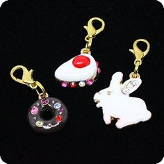 $48.00 Adore and adorn your pet with our stunning easy clip-on charms/pendants with glistening hand set Swarovski Crystals! The charm will also work great as a zipper or purse pull, bracelet charm, necklace pendant, jean charm...get creative! All Purely Charming slide-on letters, charms and clip-on pendants/charms are individually handcrafted and plated with rhodium to protect against tarnishing  ...