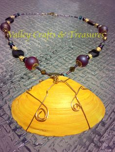 Glowing yellow ocean shell with gold wire wrapping, frosted red beads and gold glimmers on this 19 inch hand made necklace. by Valleycrafttreasures on Etsy
