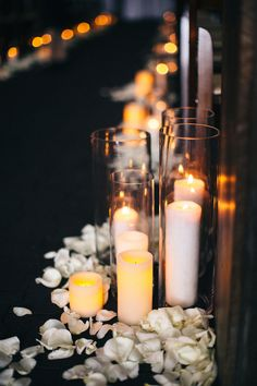 different height candles - photo by Shoda Love http://ruffledblog.com/this-elegant-wedding-has-an-amazing-escort-card-display