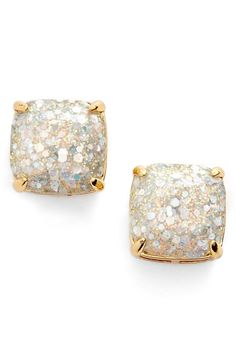 """- Sparkly glitter shines through the clear stones of these girly, party-perfect stud earrings. - 1/2"""" square. - Post back. - 14k-gold or rhodium plate/epoxy. - By kate spade new york; imported. - Item ships in a gift box."""