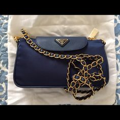"""Prada Nylon Tessuto Saffiano Clutch Sling Bag This Prada clutch sling bag in royal blue features a removable chain strap, a magnetic button flap, one external zip closure and one internal zip pocket. Size: 9""""L x 6.5""""H x 1.5""""W. Comes with the original dust bag, authenticity card, and removable chain strap. Lightweight and carefree! A pristine condition with no visible signs of wear. It is a perfect summer bag and a lovely addition to your closet! Contact me for details and pricing❤️ Prada…"""