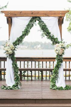 Wooden arbor, leaf garland, roses & hydrangeas, wedding ceremony // Joy Michelle Photography
