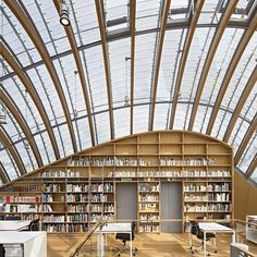 in paris, renzo piano's design of the headquarters for french film company fondation jérôme seydoux-pathé is inspired by the way creature might adapt itself to the site. a bulbous curving façade hides a luminous interior composed of 32 exposed parabolic wood arches, the longest of which assume a banana-like shape. photo by michel denancé⠀ ⠀ ⠀ see more about the project on #designboom #architecture #renzopiano #fondationjerômeseydouxpathé @renzopianobuildingworkshop