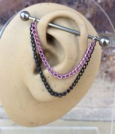 Items similar to Pink and Black Industrial Barbell Chain on Etsy Ear Peircings, Cool Piercings, Ear Piercings Cartilage, Piercing Tattoo, Tongue Piercings, Dermal Piercing, Industrial Piercing Jewelry, Industrial Barbell, Industrial Bars