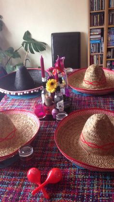 Mexican theme party. Sombreros. Sugar skulls. Flowers.
