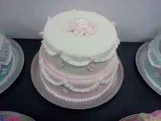 Pink and white cake with ruffles, fleur de lis, rosettes, cornelli lace and roses