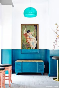 Here's a bold decorating move: painting the bottom of a work of art to match a stripe on the wall.
