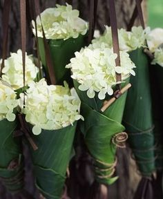 Aspidistra leaves folded bags, filled with fresh flowers, suspended from a bamboo branch which is lined with moss - website no longer exist Deco Floral, Arte Floral, Floral Design, Fresh Flowers, Beautiful Flowers, Orange Flowers, Flower Decorations, Wedding Decorations, Wedding Bouquets